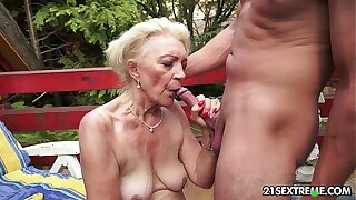 Full-grown Szuzanne plays with a young cock