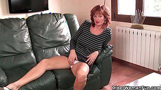 British mature Liddy masturbates in excess of the couch