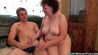 Concupiscent grandma rides cock on the day-bed